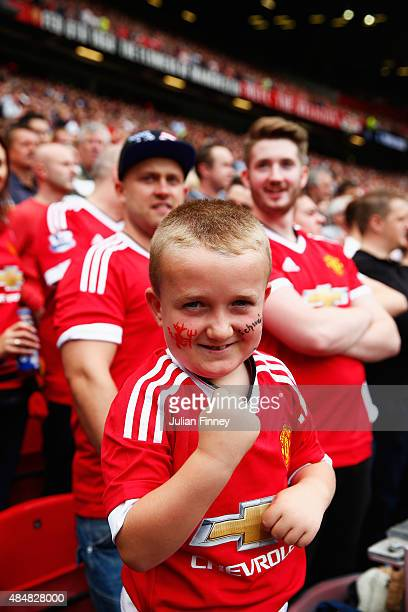 A young Manchester United fan cheers prior to the Barclays Premier League match between Manchester United and Newcastle United at Old Trafford on...
