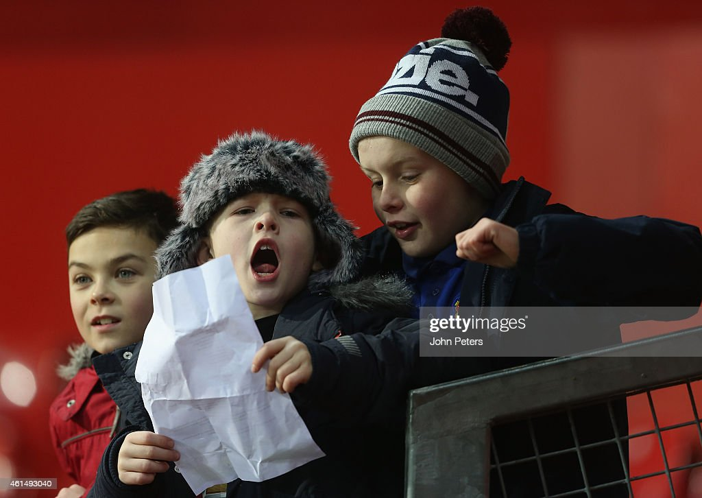 Young Manchester United fans watch from the stand during the FA Youth Cup Fourth Round match between Manchester United U18s and Hull City U18s at Old Trafford on January 13, 2015 in Manchester, England.