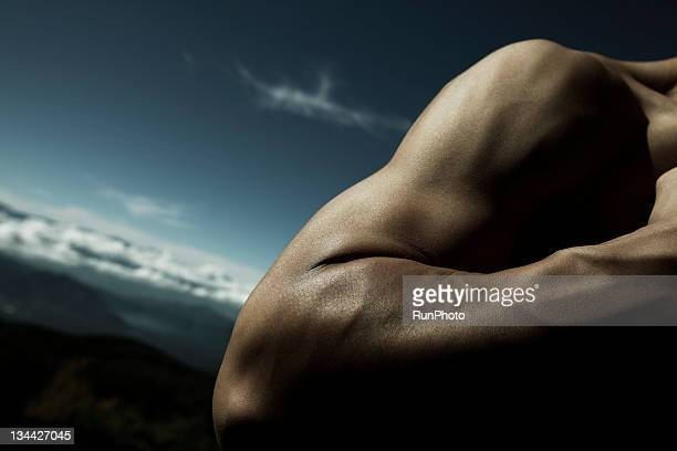 young man's arm close-up in nature