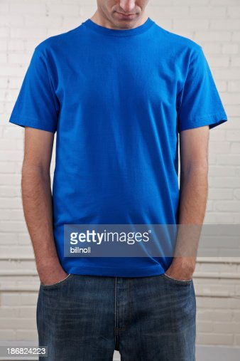 Young man's chest with blank blue shirt