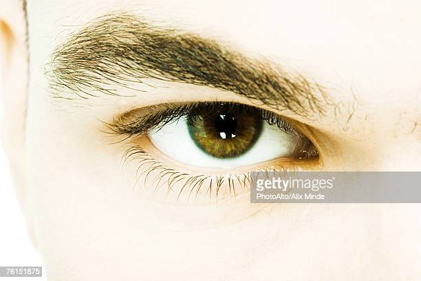 'Young man's eye, extreme close-up'