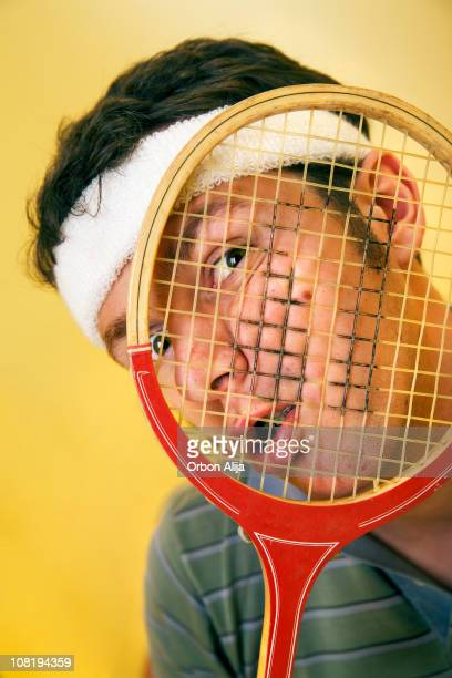 Young Man's Face Squished By Racket