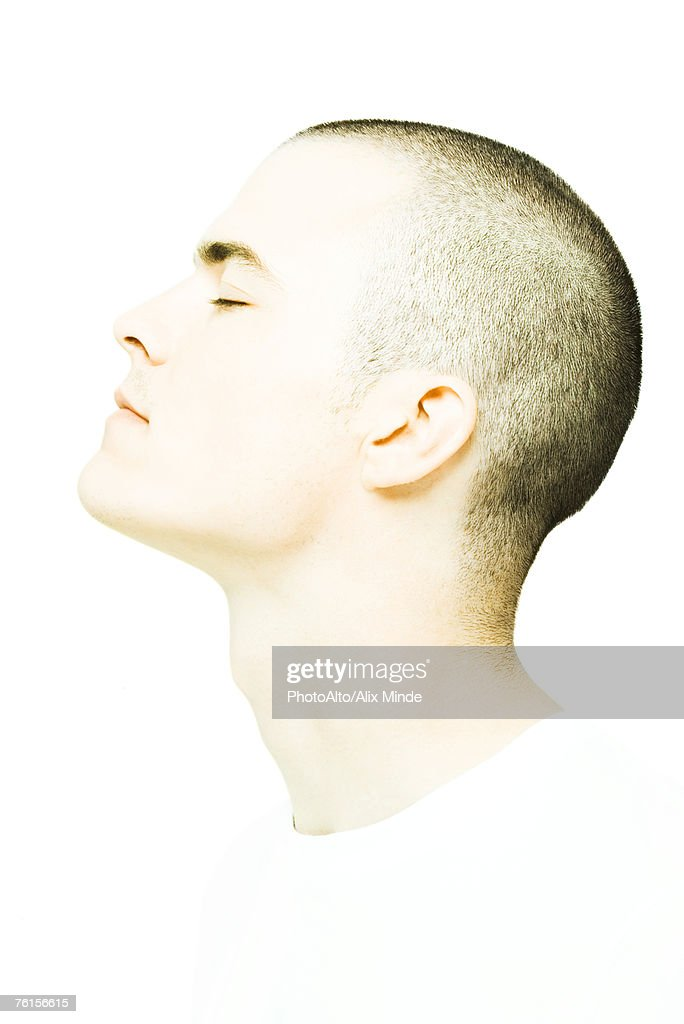 'Young man's head, eyes closed, profile'