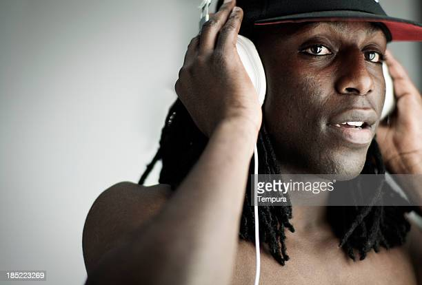 Young man's portrait listenign music