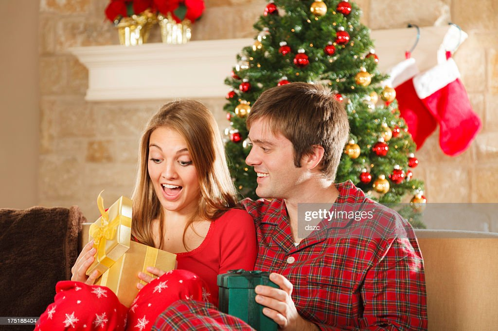 Ordinary Christmas Gifts For Married Couples Young Part - 6: Young Married Couple On Christmas Morning Opening Gifts : Stock Photo