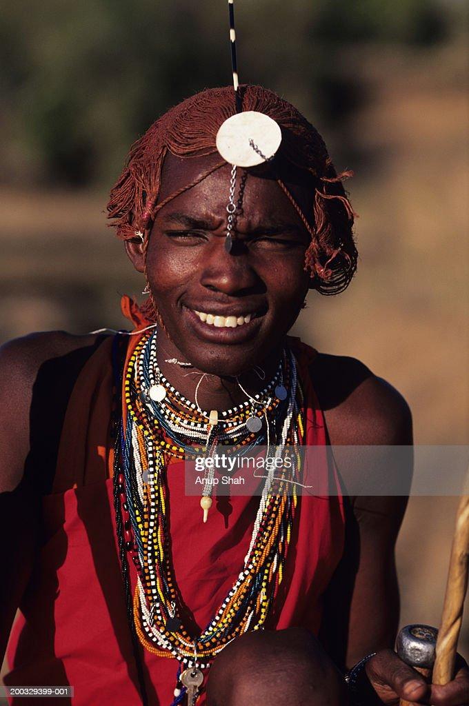 Young Masai posing outdoors, Masai Mara National Reserve, Kenya, portrait : Stock Photo