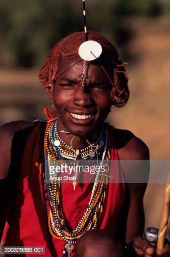 Young Masai posing outdoors, Masai Mara National Reserve, Kenya, portrait : Stock Photo