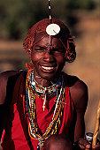 Young Masai posing outdoors, Masai Mara National Reserve, Kenya, portrait
