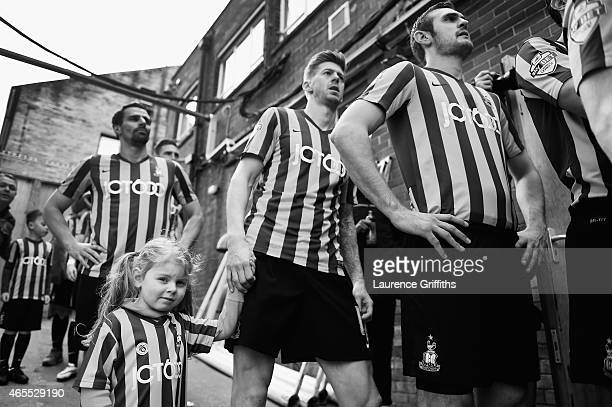 A young mascot holds the hand of Jon Stead of Bradford City as they wait to take the field prior to the FA Cup Quarter Final betweeen Braford City...