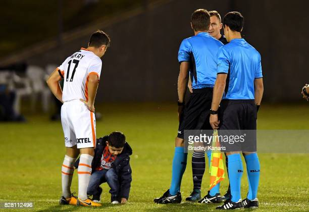 A young mascot tosses the coin before the FFA Cup round of 32 match between the Brisbane Roar and the Melbourne Victory at Perry Park on August 9...