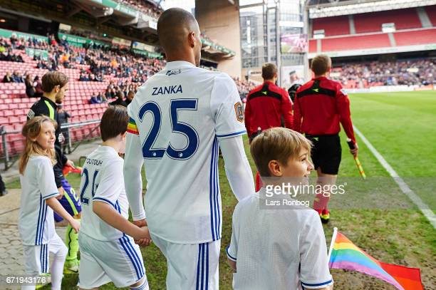 Young mascots walking with Mathias Zanka Jorgensen of FC Copenhagen on to the pitch prior to the Danish Alka Superliga match between FC Copenhagen...