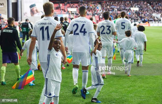 Young mascots walking with the players on to the pitch prior to the Danish Alka Superliga match between FC Copenhagen and FC Midtjylland at Telia...