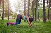 strong sports woman doing push ups and got himself in air