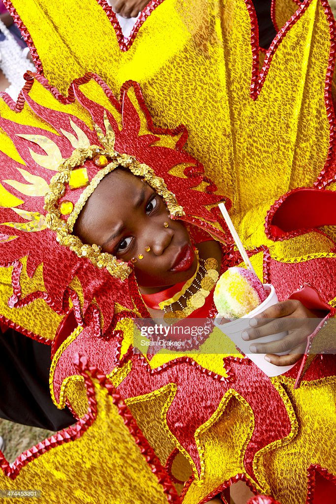 A young masquerader in the Divas & Legends band by Bois Canot Productions leads her group to the stage at the Red Cross Junior Carnival competition on February 22, 2014 in Port of Spain, Trinidad & Tobago.