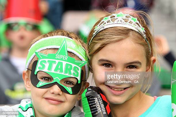 Young Melbourne Stars fans show their support during the Big Bash League match between the Melbourne Stars and the Brisbane Heat at Melbourne Cricket...