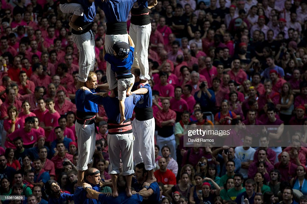 A young member of the Colla 'Vila de Gracia' climbs up as they construct a human tower during the 24th Tarragona Castells Comptetion on October 7, 2012 in Tarragona, Spain. The 'Castellers' who build the human towers with precise techniques compete in groups, known as 'colles', at local festivals with aim to build the highest and most complex human tower. The Catalan tradition is believed to have originated from human towers built at the end of the 18th century by dance groups and is part of the Catalan culture.