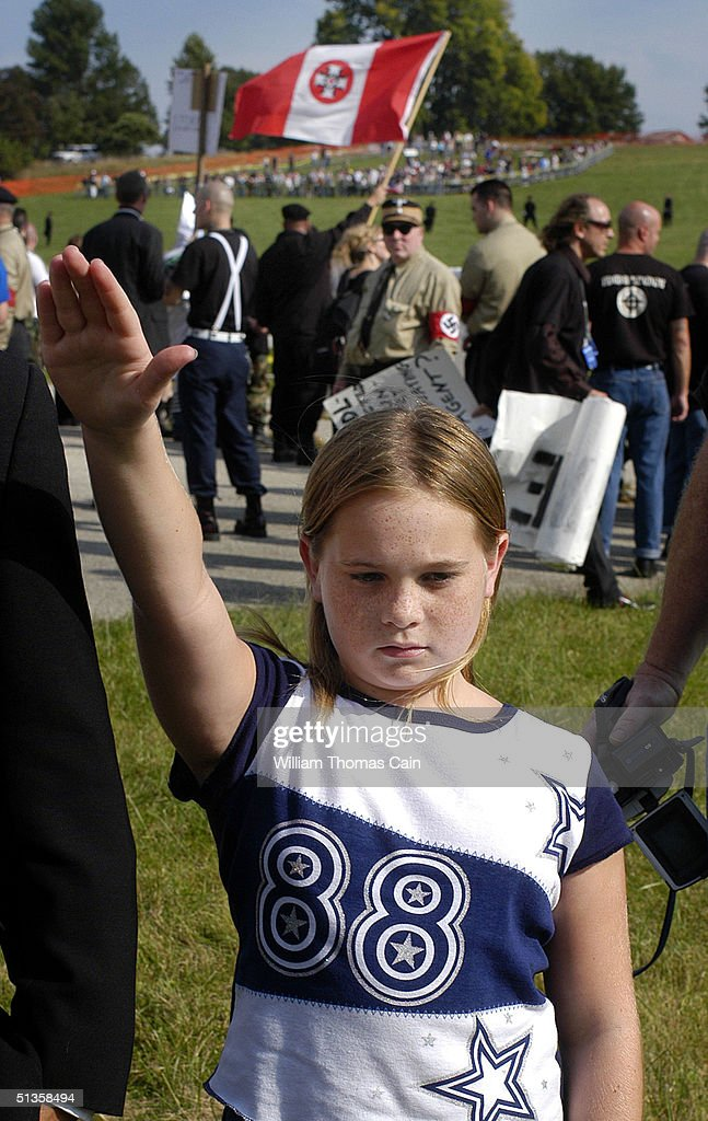 A young member of the Ku Klux Klan salutes during American Nazi Party rally at Valley Forge National Park September 25, 2004 in Valley Forge, Pennsylvania. Hundreds of American Nazis from around the country were expected to attend.