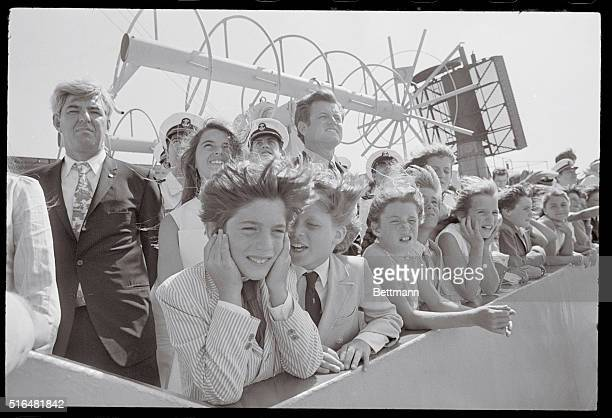 Young members of the Kennedy family react as the giant horns aboard the aircraft carrier John F Kennedy are sounded