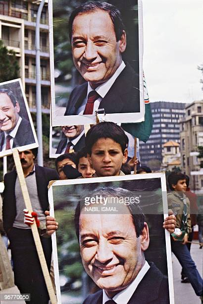 Young members of the proSyrian Amal militia the first political organization of Lebanon's Shiite Muslims hold portraits of their leader Nabih Berri...
