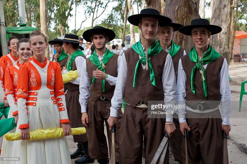 Young men and women boys and girls teenagers wearing traditional Gaucho dancing costumes for a performance Reponte da Cancao music festival and song...