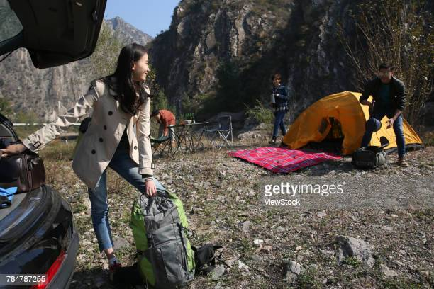 Young men and women camping