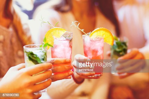 Young men and women drinking cocktail at party : Stock Photo