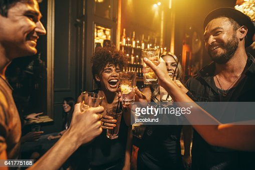Young men and women enjoying a party : Stock Photo
