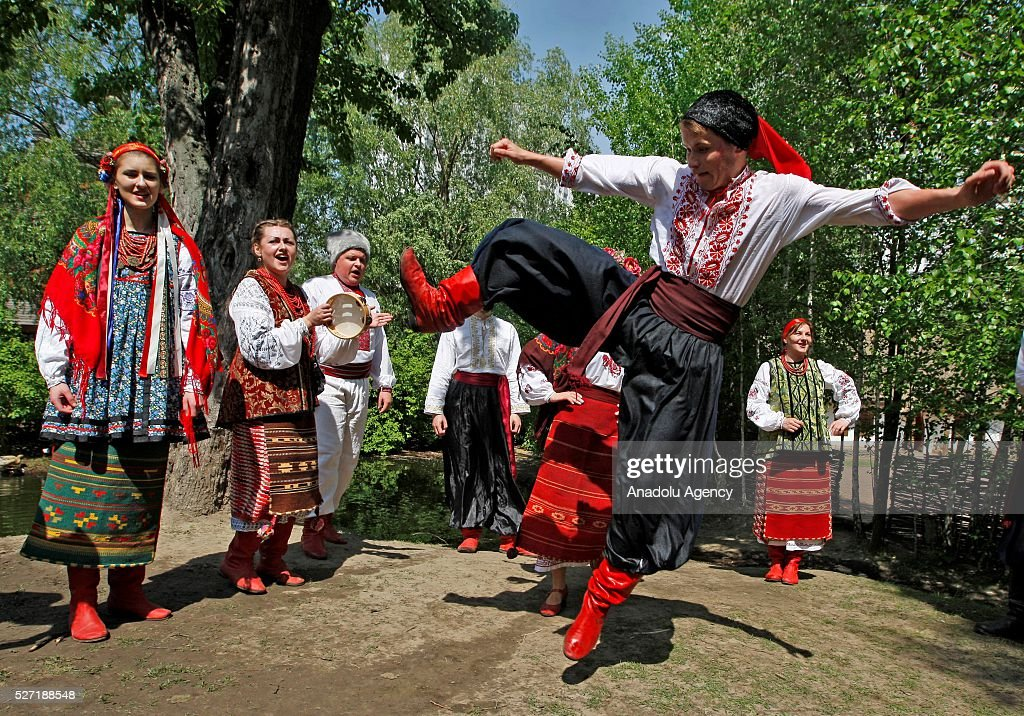 Young men and women in Ukrainian traditional clothes dance during folk Easter Tradition of pouring water called 'Pouring Monday' in open air Cossack village 'Mamaeva Sloboda', Ukraine,on May 02, 2016. The tradition of pouring water when single guys pour unmarried girls by water is celebrated on the first Monday after Orthodox Easter.