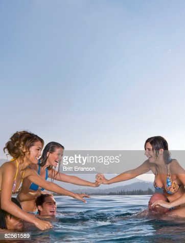 Authoritative Girls wreatling in pool quite