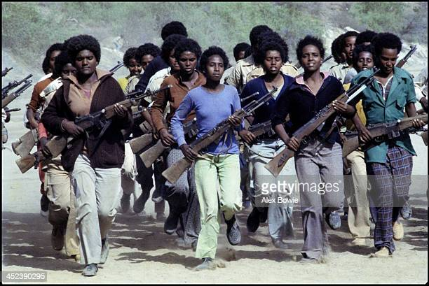 Young men and women undergo military training at an Eritrean People's Liberation Front camp in the mountains of northern Eritrea 18th June 1978