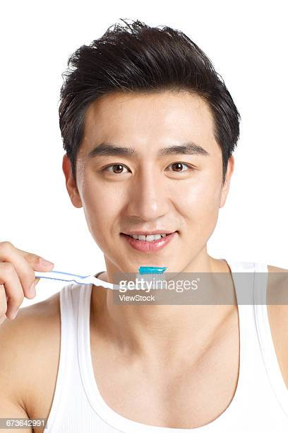 Young men are brushing his teeth