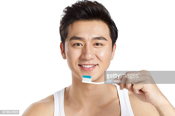 Young men are brushing their teeth