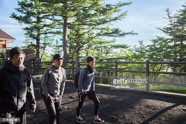 Young men are climbing to Mount Fuji