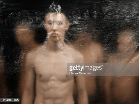 young men behind plastic screen : Stock Photo