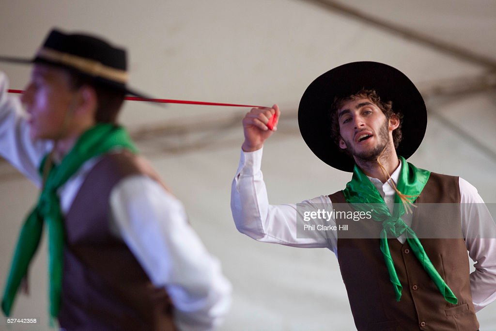 Young men boys teenagers dancing on stage in couples wearing traditional Gaucho dancing costumes for a performance Reponte da Cancao music festival...