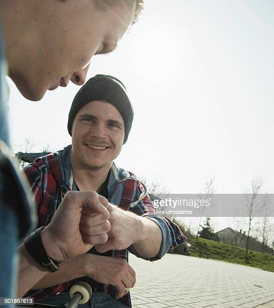 Young men doing fist bump