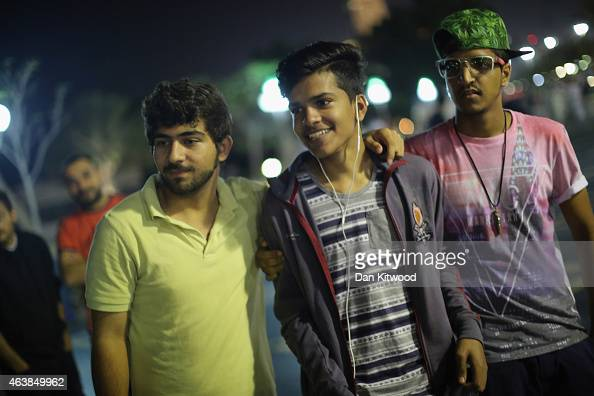 Young men gather to watch some break dancing on the Corniche on February 5 2015 in Abu Dhabi United Arab Emirates Abu Dhabi is the capital of the...