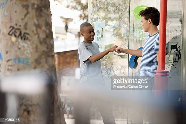 Young men greeting each other with fist bump