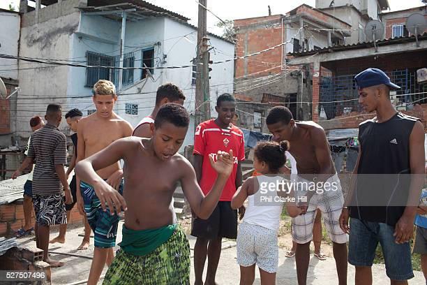 Young men guys on a rooftop dancing passinho to funk Carioca Baile funk Vila Valquiere West Zone Zona Oueste Rio de Janeiro