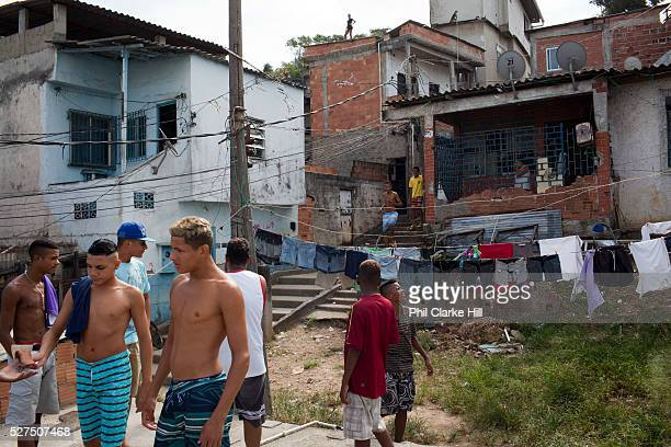 Young men guys on a rooftop with washing hanging and buildings in the background in Vila Valquiere West Zone Zona Oueste Rio de Janeiro