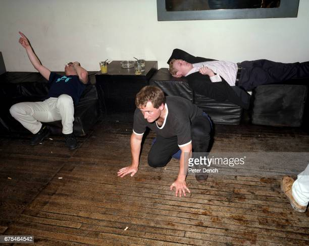 Young men lounge around the dance floor of a members club in the upmarket Kings Road area of west London May 2000