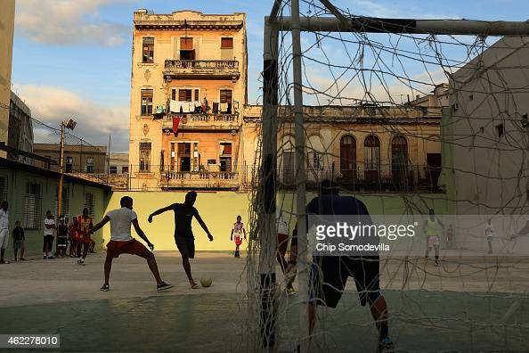 Young men play soccer on the concrete court at the Camilo Cienfuegos Sports Center January 25 2015 in Havana Cuba Diplomats from the United States...