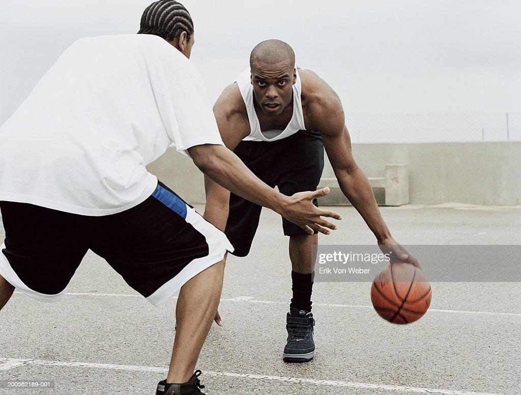 Young men playing basketball : Stock Photo