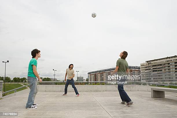Young men playing football