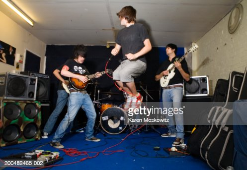 Young men playing musical instruments during band practice