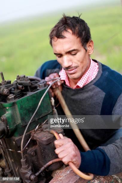 Young men repairing engine
