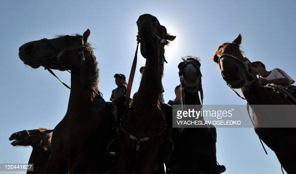 Young men ride their horses during a hunting festival in the Tamchi village near the IssykKule lake some 220 kms outside Bishkek on August 6 2011 AFP...