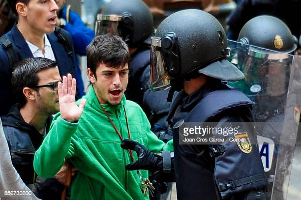 A young men speaking with the Spanish national police during the Catalonia independence referendum declared ilegal by the Spanish government on...