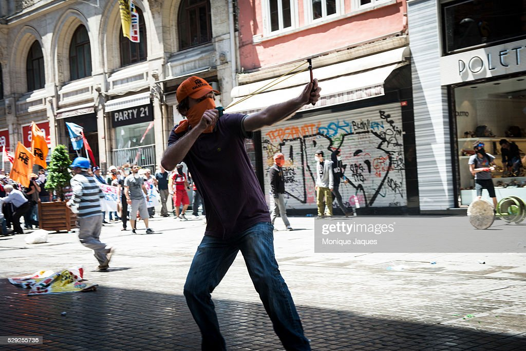 Young men throw rocks and bottles at the police Protests in Istanbul Turkey continue Protests began as a fight to save Gexi Park in central Istanbul...