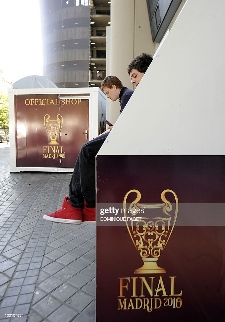 Young men wait outside Santiago Bernabeu stadium in Madrid on May 21, 2010 ahead of the UEFA Champions League final. Inter Milan will face Bayern Munich for the UEFA Champions League final match to be played at the Santiago Bernabeu Stadium in Madrid on May 22, 2010.